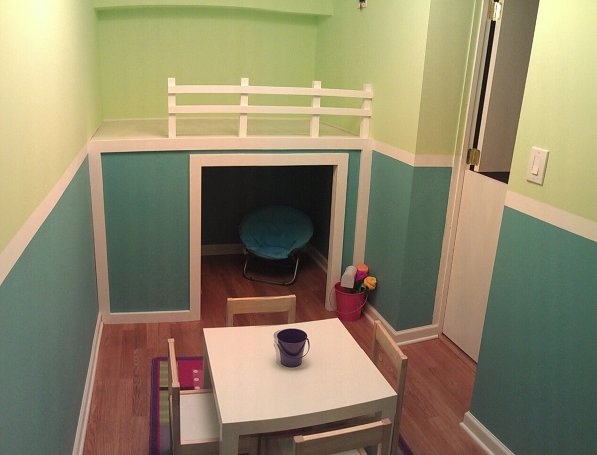 white playhouse loft bed in small playroom diy