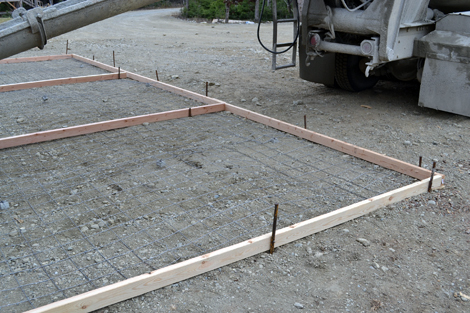 Dining table concrete dining table diy for Pouring your own concrete driveway