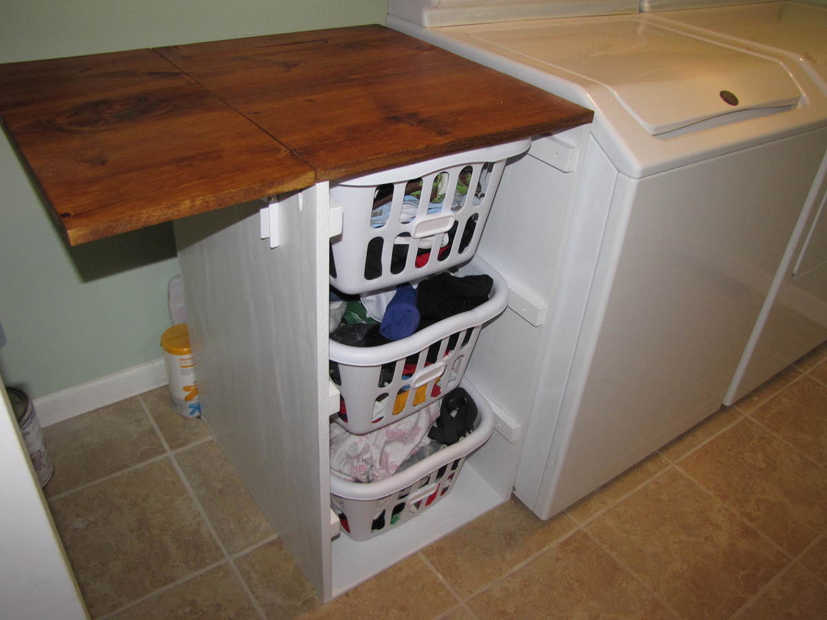 Captivating Laundry Cabinets   Shorter Brook Laundry Basket Dresser With Folding Table