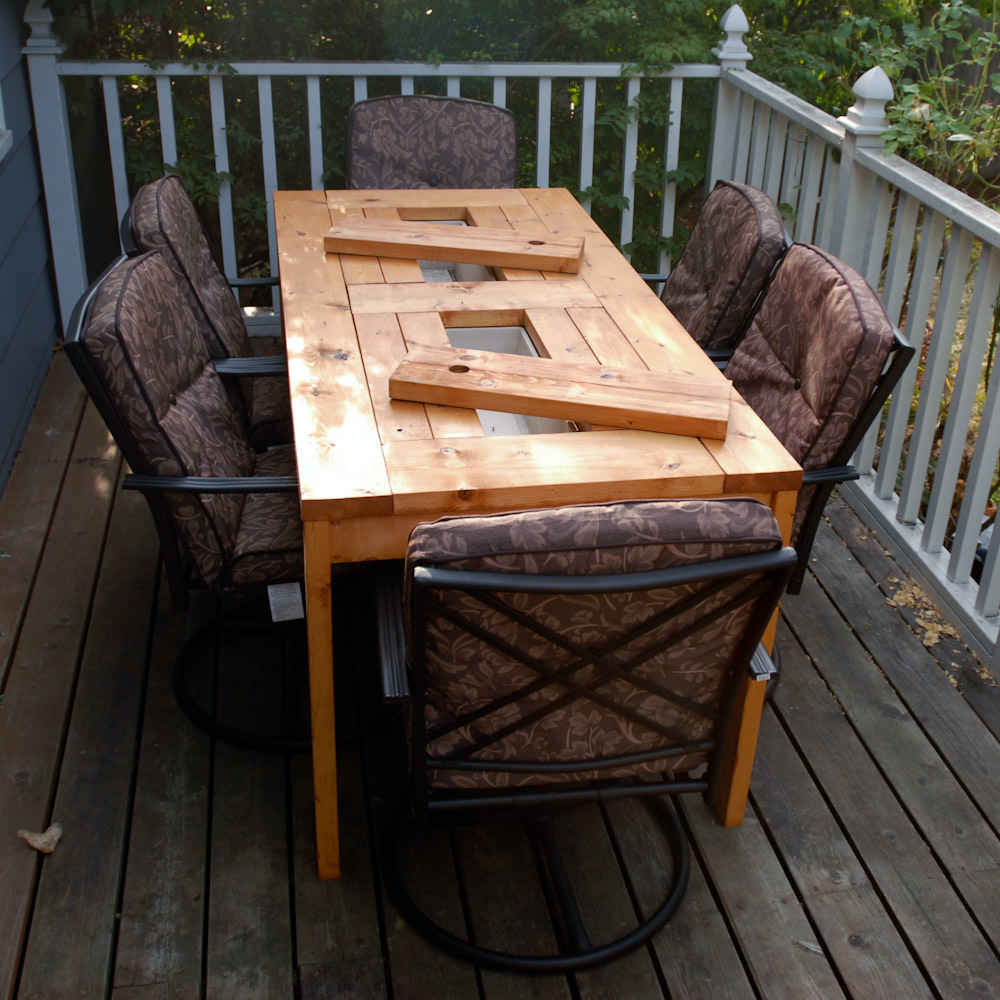 Patio Table with Built-in Beer/Wine Coolers with lids off