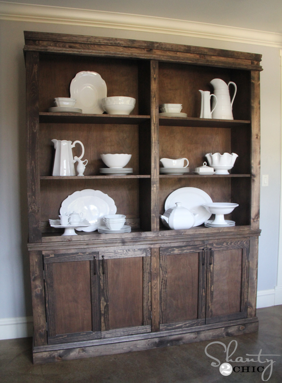 farmhouse style hutch with white dishes