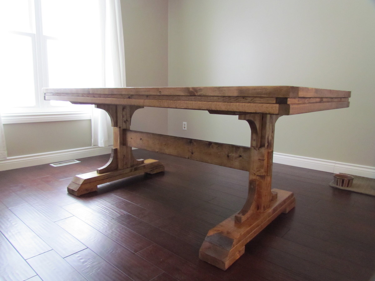 My hubby took the plans from the Triple Pedestal Farmhouse Table and ...