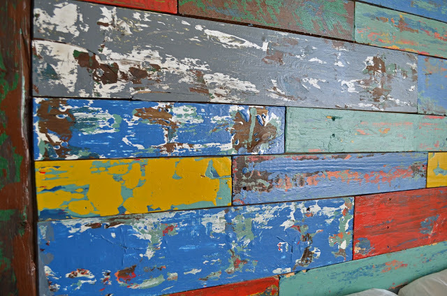 Pour the paint on a plate and dip the scrap in the paint and then paint  your boards with the scrap. This will give you the uneven paint look. - Ana White Reclaimed Boat Wood Finish - DIY Projects