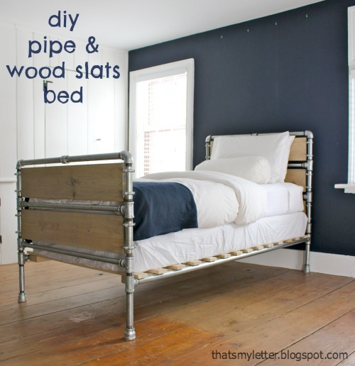 Lovely Pipe and Wood Slat Bed