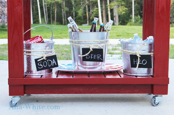 shelf on red bar cart with beverages in galvanized buckets with ice