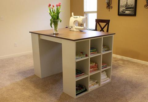 By simply building two of the cubby bookcases from the Modular Offfice  Collection and adding a desktop, voila! we've got a stylish, simple project  table.