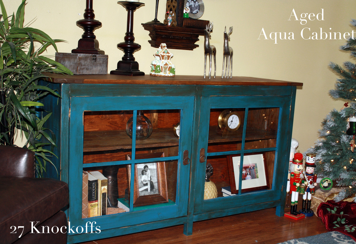 Using Vaseline To Distress Aged Aqua Cabinet