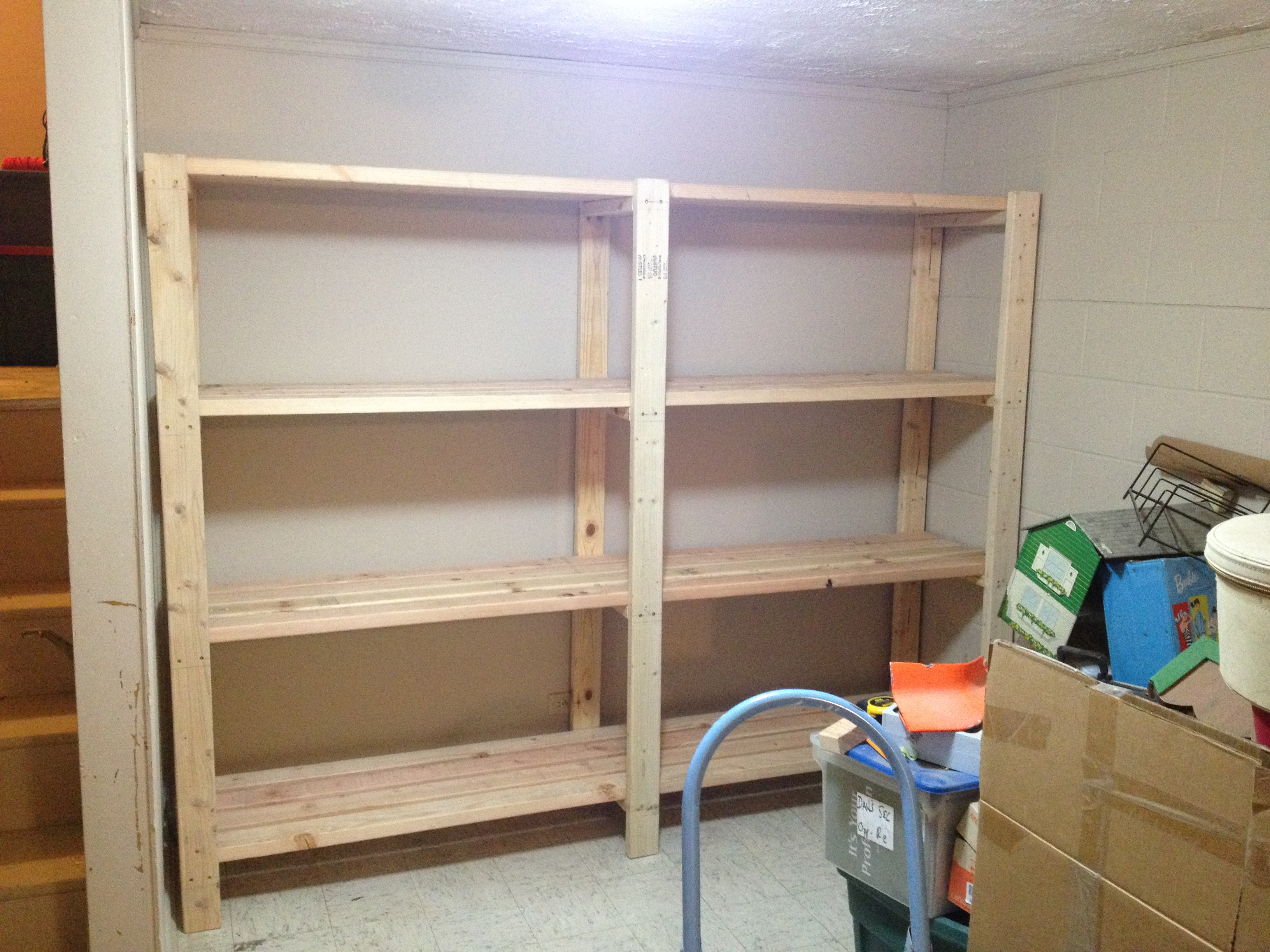 Ana white 2 x 4 garage shelves built into basement for Garage storage plans