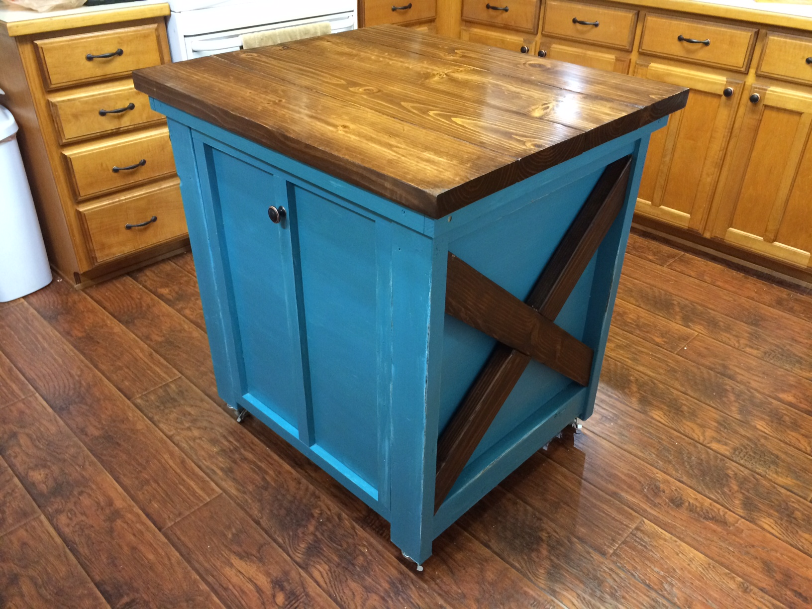 white kitchen island with trash bin diy projects