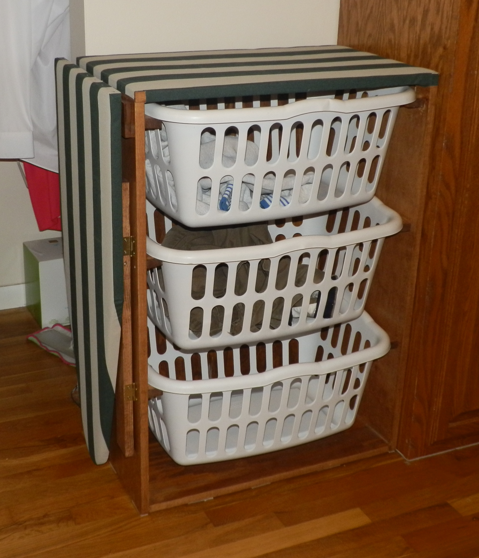 laundry drop down ironing board | Laundry basket dresser with a drop-down ironing board ...