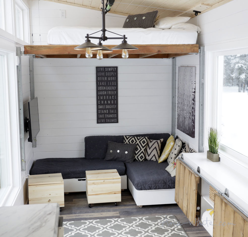 Open concept rustic modern tiny house photo tour and sources ana to achieve this we had to do away with a bedroom a loft bed would have required stairs consuming much space so we elevated the bed using garage door rubansaba