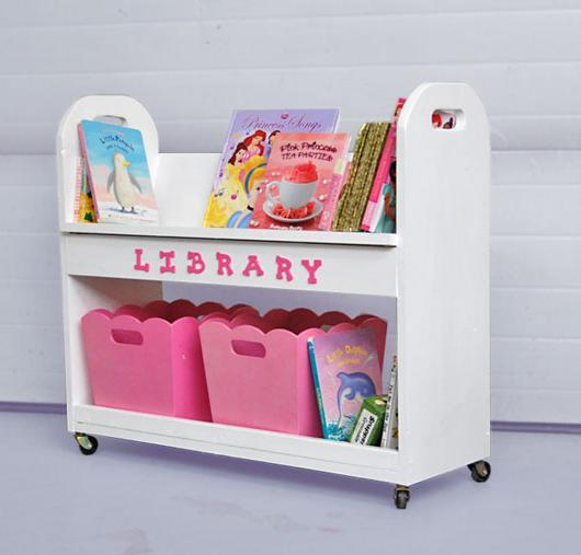 A Rolling Cart Featuring A Angled Top Book Shelf Perfect For Keeping Books  In Place, And A Large Bottom Shelf Perfect For Baskets Or Bins.