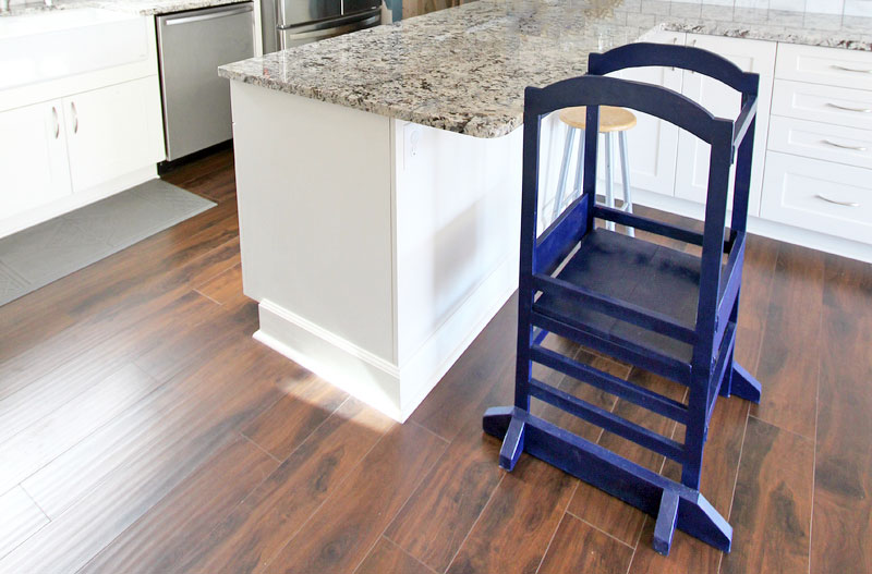 blue little helper tower in white kitchen