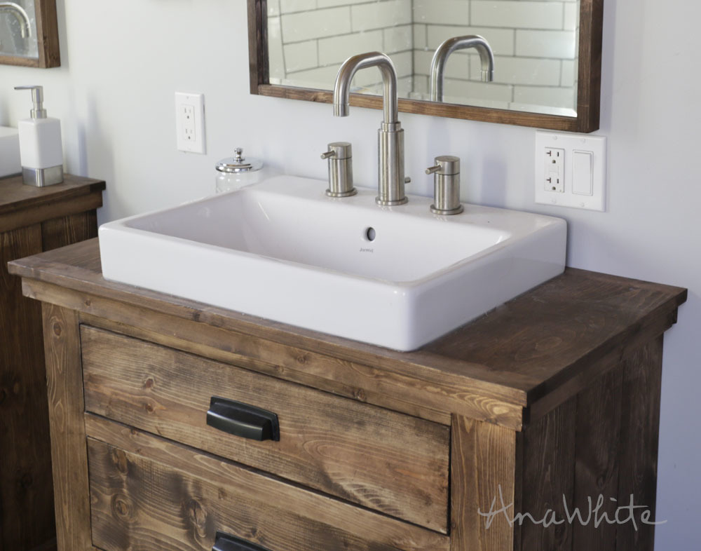 farmhouse sink on rustic wood vanity