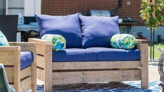 Modern outdoor loveseat with blue cushions