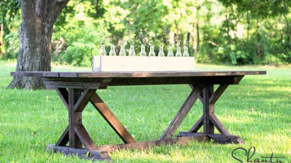 dark wood stained farmhouse table with X legs and cross bracing
