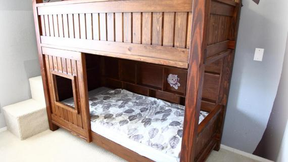 Custom stained wood bunk bed with stairs