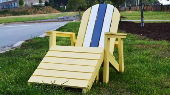 yellow adirondack chair with footstool