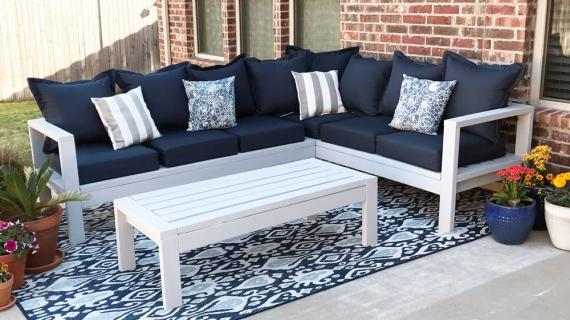 outdoor sofa sectional made from 2x4s with blue cushions