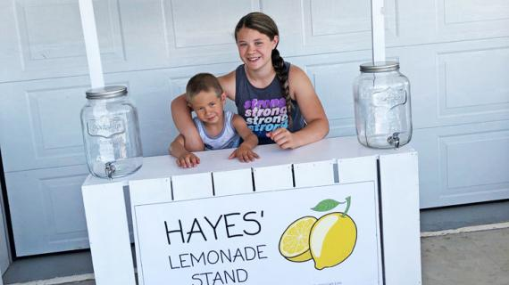 diy lemonade stand painted white with printable banner