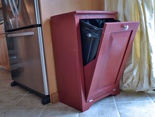 wood trash bin cabinet painted red with door open