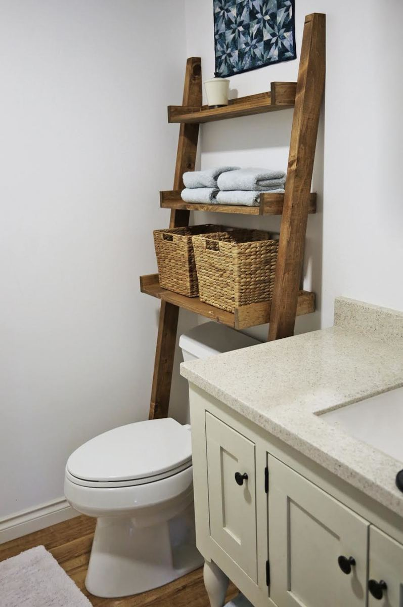 easy to make over the toilet storage leaning shelf add storage for towels and tolietries without drilling holes in the wall